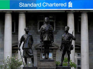 Standard Chartered Bank: StanChart to take $900 million charge over