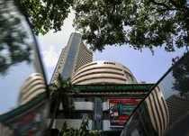 Bombay Stock Exchange building is pictured next to police van in Mumbai