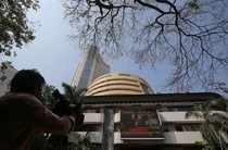 FILE PHOTO: A television journalist films the facade of the Bombay Stock Exchange during the telecast of India's interim budget, in Mumbai