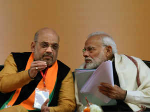 Prime Minister Narendra Modi speaks with BJP National President Amit Shah  TNN