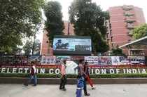 People walk past the Election Commission of India office building in New Delhi
