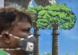 New Delhi: A man wears an anti-pollution mask for protection against air polluti...