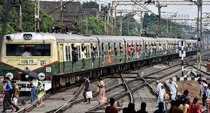 Kolkata: Commuter cross a railway track at Ballygunge Railway Station during off...