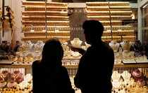 People look at gold jewelleries at a jewellery shop at the Grand Bazaar in Istanbul