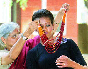 Michelle Obama packs bagful of Indian goodies for daughters