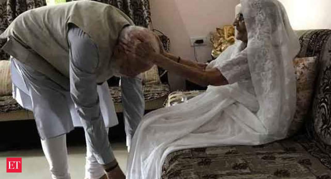 Visuals of PM Modi with his mother before casting his vote