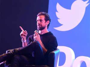 Twitter triples profits, global user base steadies