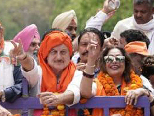 Anupam Kher (L) by wife Kirron's side as she files nomination from Chandigarh