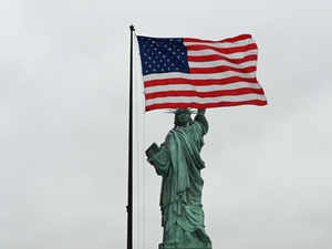 A view of the US flag and the Statue of Liberty from the roof of the museum during a press preview at the new Statue of Liberty Museum AFP