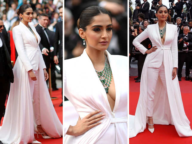 Actress Sonam Kapoor was a vision in white as she walked the red carpet in a white tuxedo by designer Ralph And Russo. The asymmetrically draped tailleur featured an overskirt with a two metre train. She completed her look with a layered, emerald necklace by luxury jewellery brand Chopard and matching heels by Jimmy Choo.