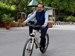 Harsh Vardhan arrived on a bicycle at Nirman Bhawan to take charge as Union Health Minister in the newly-elected PM Modi's cabinet in New Delhi.