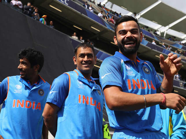 The next game, played by  Virat Kohli (R), MS Dhoni (C) & Jasprit Bumrah (L), is against defending champions Australia, that will be played at The Oval in London.