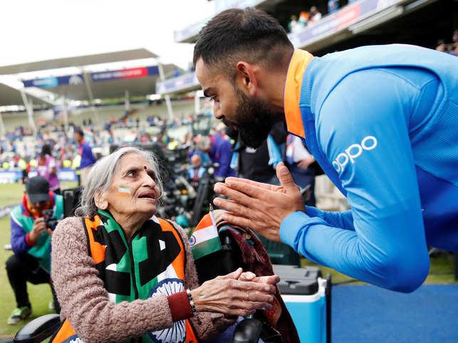 Virat Kohli (R) sought Charulata Patel's blessings for the next match on Saturday.