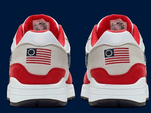 379c25bd Nike's 'flag' sneakers stir political outrage in US, footwear brand ...