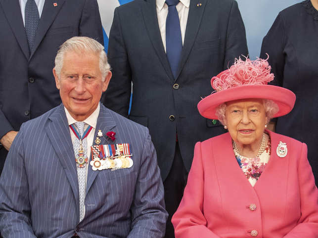 ​​After handing over her powers, Queen Elizabeth (R) will keep her royal title, but Prince Charles (L) will step up to perform the majority of her duties,​