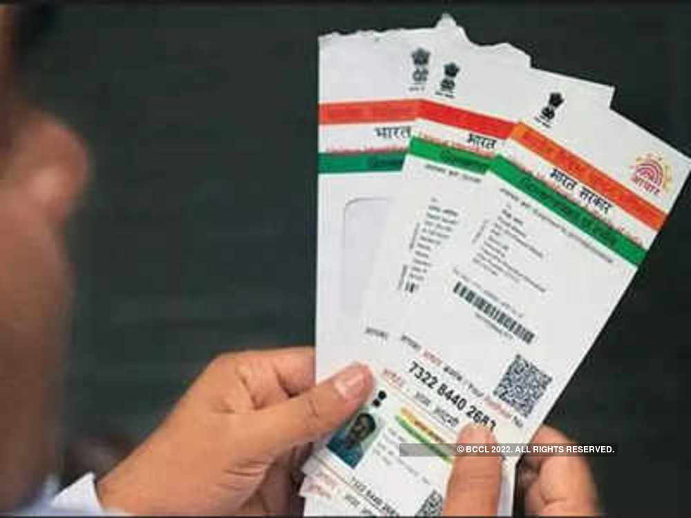 Act against agents harassing people seeking Aadhaar update: Minister to officials