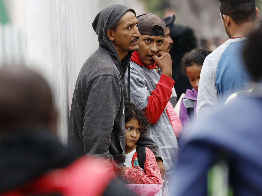 Anxious immigrants wait to learn effect of new asylum policy