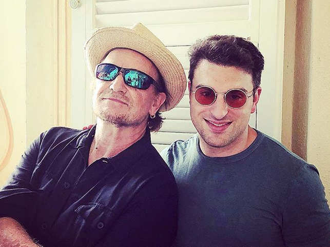 """On his Instagram post with Bono(L), Brian Chesky (R) wrote, """"We switched glasses and I got to wear the rose color glasses, but he still looked cooler."""""""
