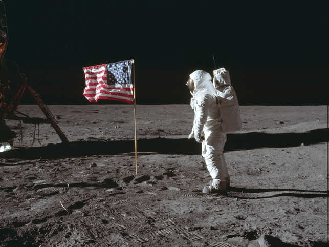 The 1969 photo made available by NASA shows astronaut Buzz Aldrin Jr (in pic) poses for a photograph beside the U.S. flag on the moon during the Apollo 11 mission. 