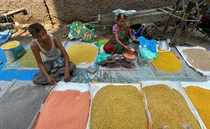 New Delhi: A shop-keeper attends a customer at the wholesale market for pulses a...