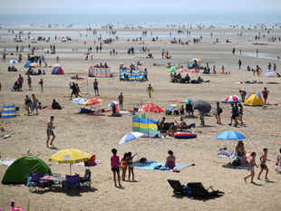 Temperatures in Britain reached a record high of 38