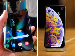 Galaxy Fold (L) sports a 10MP camera on the front, while iPhone XS Max's (R) selfie camera is 7MP​.