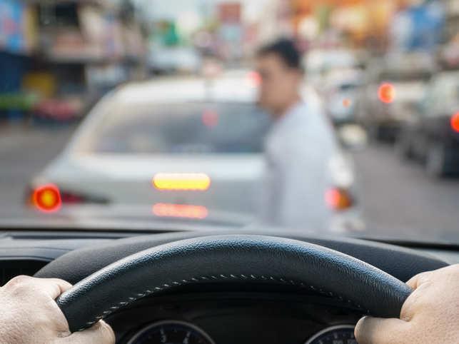 Curb pedestrians or driverless cars?