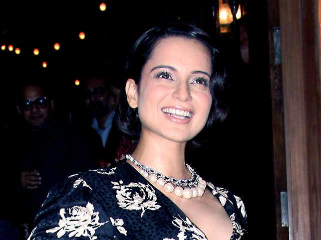 Kangana pairs Rs 600 saree with Givenchy coat and Prada handbag
