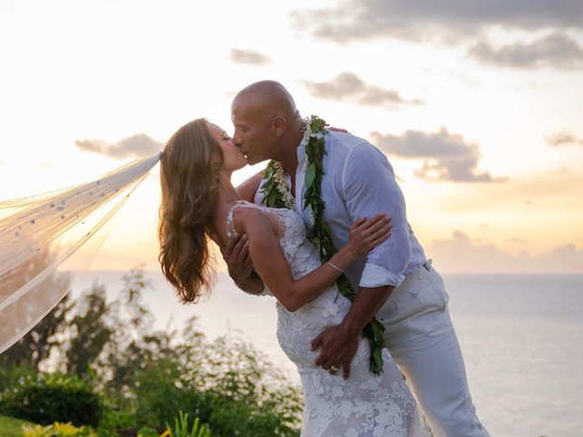 The couple shared a kissing picture against the sunset backdrop with Lauren Hashian's veil blowing in the wind. 