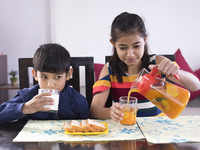 Let kids enjoy a glass of juice, it may improve their diet