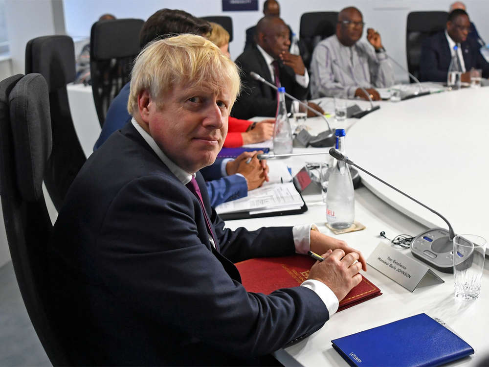 Boris Johnson seeks to woo Donald Trump, talk tough to EU at G7