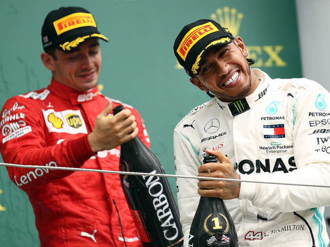 NORTHAMPTON, ENGLAND - JULY 14: Race winner Lewis Hamilton of Great Britain and Mercedes GP celebrates on the podium with third placed Charles Leclerc of Monaco and Ferrari during the F1 Grand Prix of Great Britain at Silverstone on July 14, 2019 in Northampton, England. (Photo by Bryn Lennon/Getty Images)