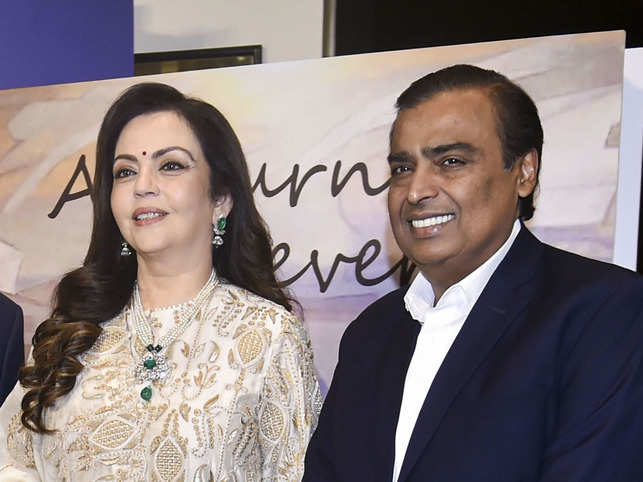 Nita Ambani opted for an ivory-gold ensemble, and Mukesh Ambani looked sharp in a tailored suit.