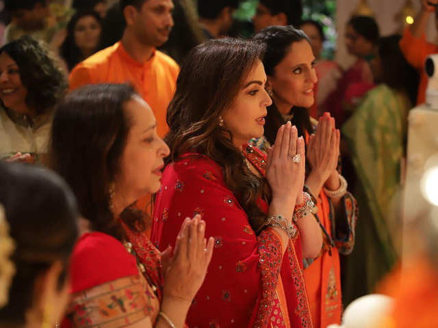Nita Ambani stuns in red; Mukesh, Isha, Anant in hues of pink as they  celebrate Ganesh Chaturthi with B-town - Welcoming 'Bappa' Home | The  Economic Times