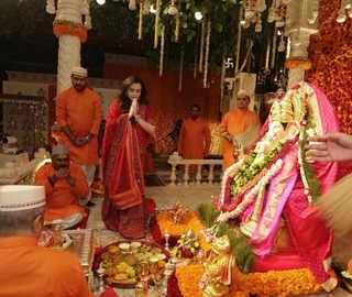 Ganesh Chaturthi: Nita Ambani stuns in red; Mukesh, Isha, Anant in hues of pink