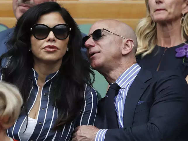 Jeff Bezos and girlfriend Lauren Sanchez sail across Venice's canals in a boat