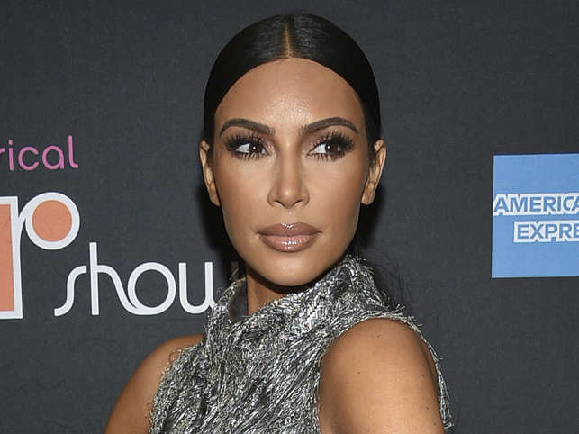 Kim Kardashian ditched barbecue time to study contracts.