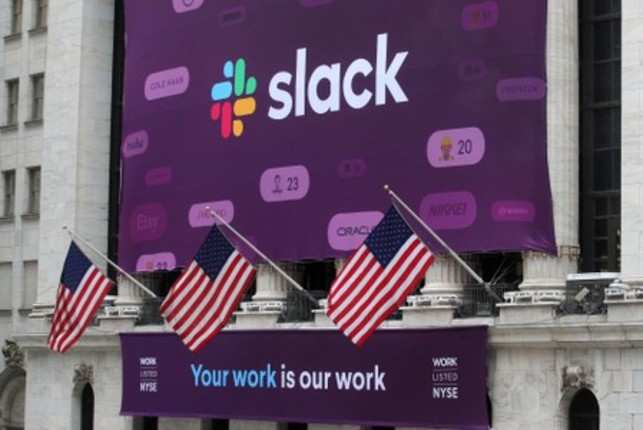 The Slack Technologies Inc. logo is seen on a banner outside the New York Stock Exchange (NYSE) during thew company's IPO in New York