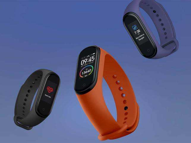 Xiaomi Mi Band 4 (in pic) sports a 0.95-inch AMOLED touchscreen colour display