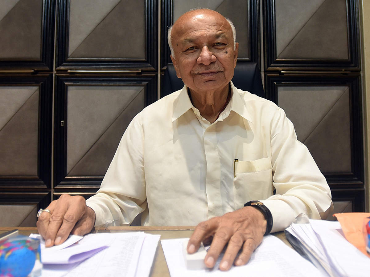 ncp must merge with congress sushil kumar shinde