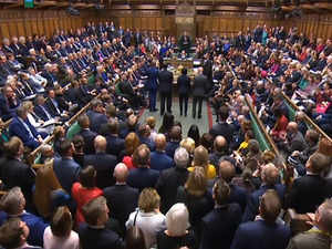 UK Parliament votes to postpone decision on deal