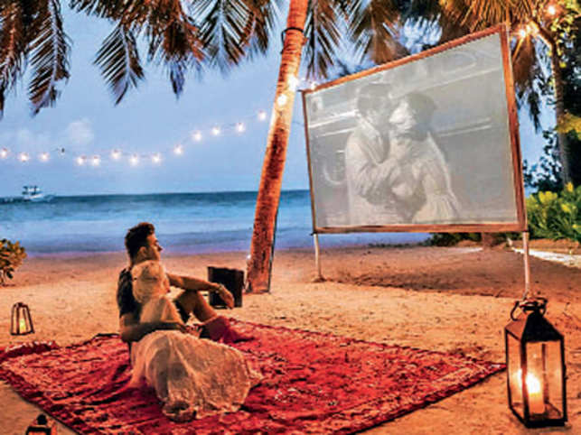 Romantic getaways beckon: Luxury resorts in Maldives offer a cosy outdoor movie experience.