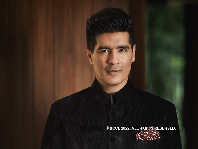 Manish Malhotra likes to add 'a little bit of drama' to his outfits with a scarf.