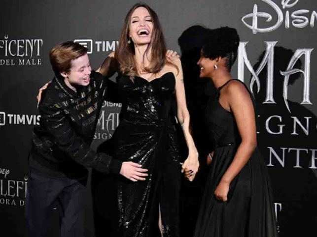 Jolie, center, poses with her kids Shiloh Nouvel, left, and Zahara Marley, right,  during the European premiere of 'Maleficent: Mistress of Evil'.