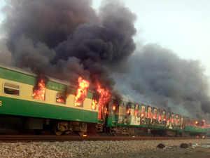 Massive fire on moving train kills dozens in Pakistan