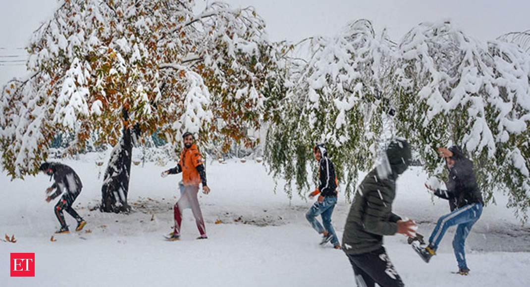Tourists enjoy snowfall in J&K's Pahalgam