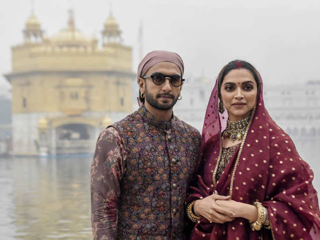 While Deepika Padukone looked like a newly-wed bride in maroon, Ranveer Singh opted for a kurta pyjama with floral Nehru jacket for the occasion.