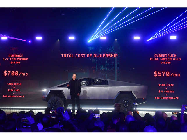 Elon Musk said the truck, which looked liked a futuristic armoured vehicle, will have a starting price of $39,900 and a maximum range of 500 plus miles.