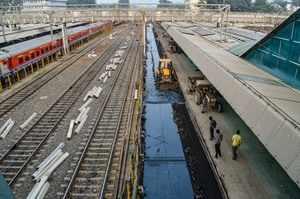 Workers clean railway tracks, in Jabalpur (PTI Photo)