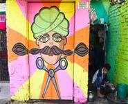Rainbow murals bring cheer to Delhi slum